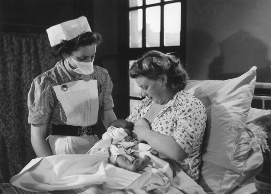 Photo of a nurse and mother and baby