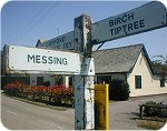 Wooden finger-post: Messing, Birch, Tiptree
